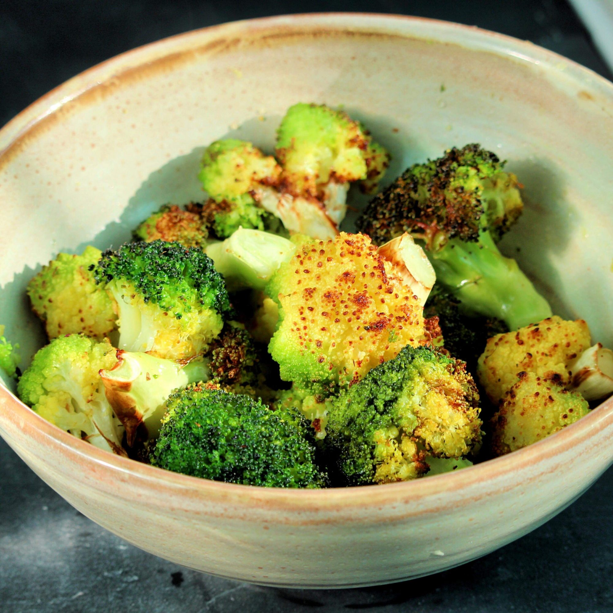 bowl of air-fried broccoli and cauliflower