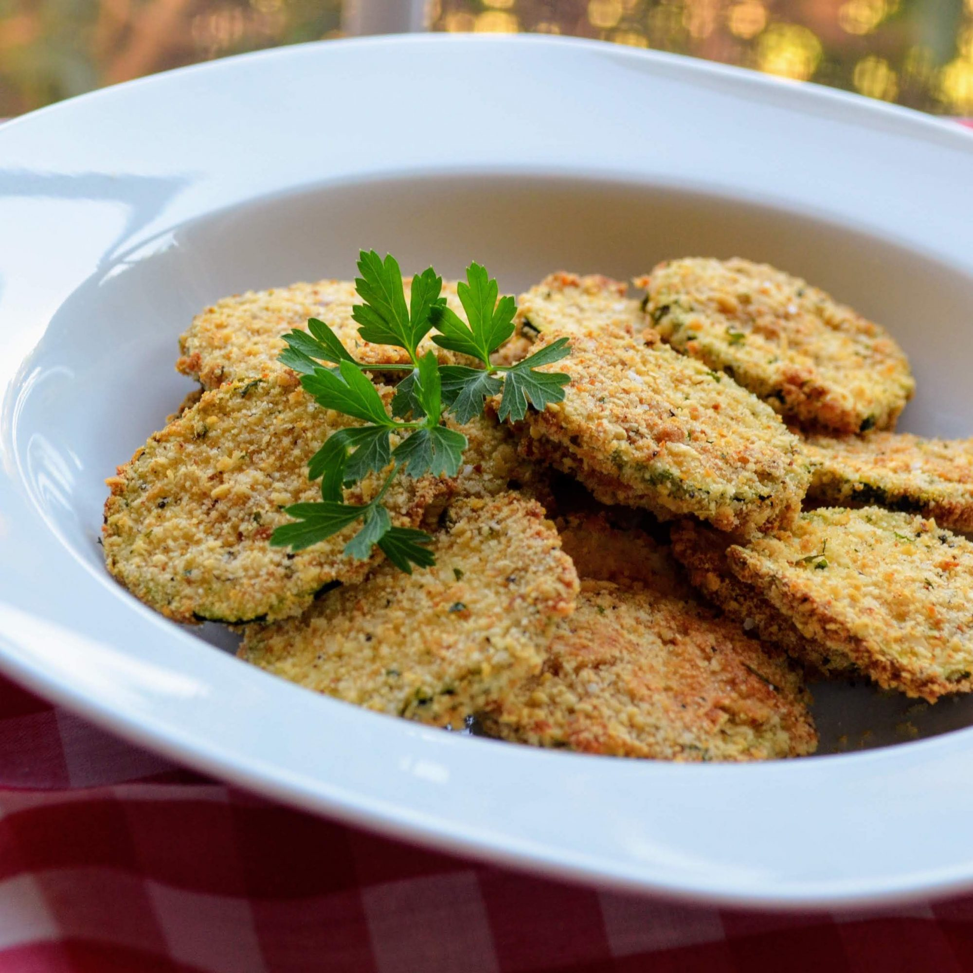 air-fried zucchini chips in a white bowl
