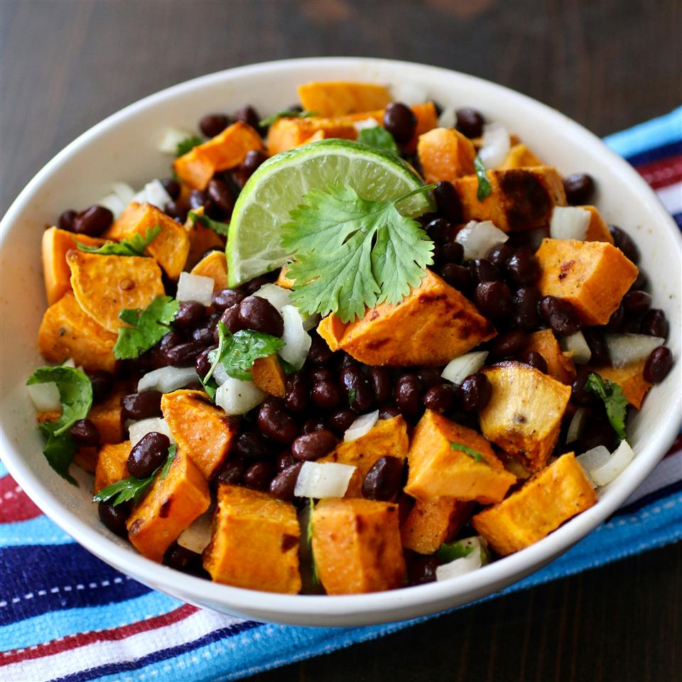 Vegan Black Bean and Sweet Potato Salad with a wedge of lime