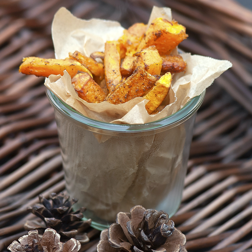 butternut squash fries in a glass container