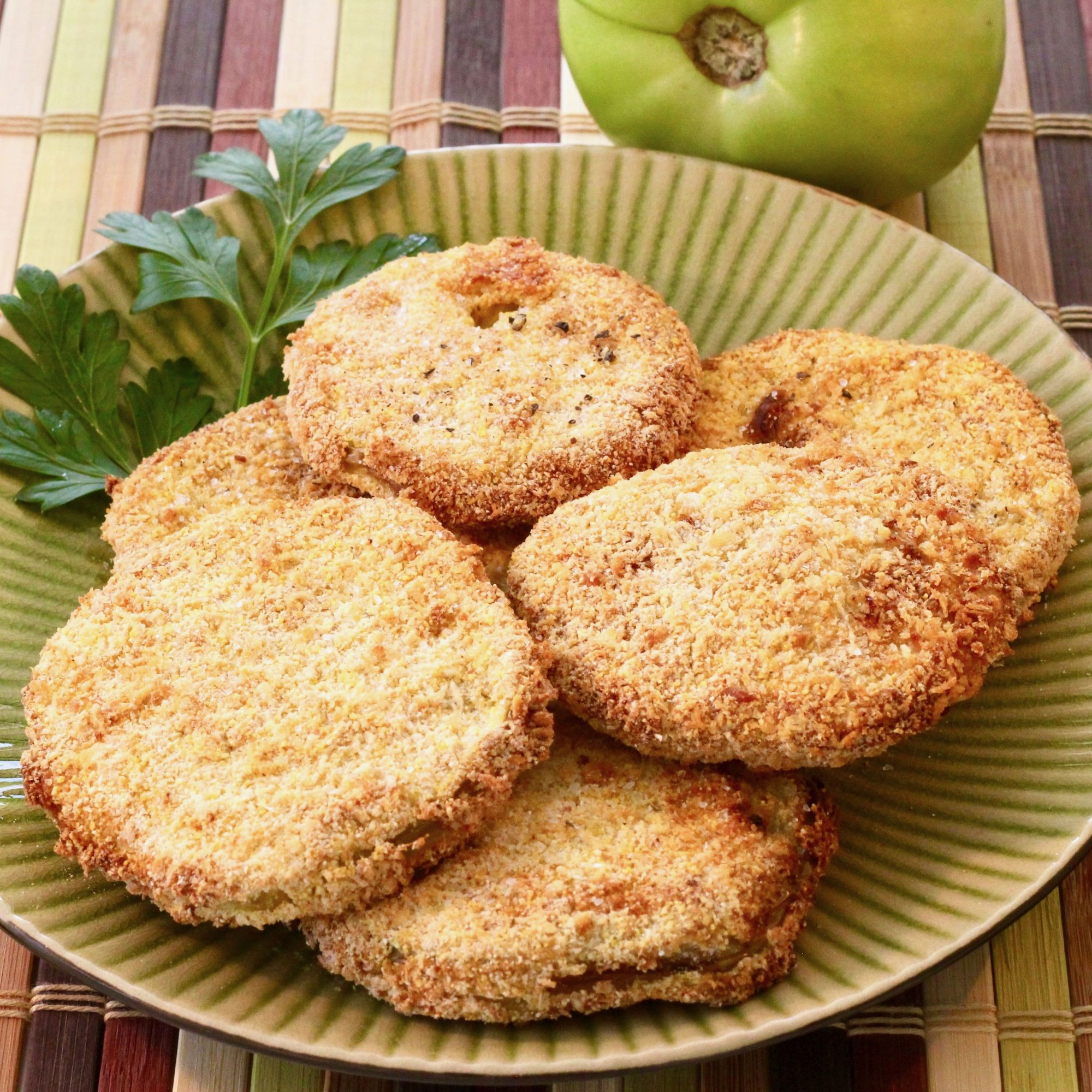 air-fried green tomatoes on a green plate