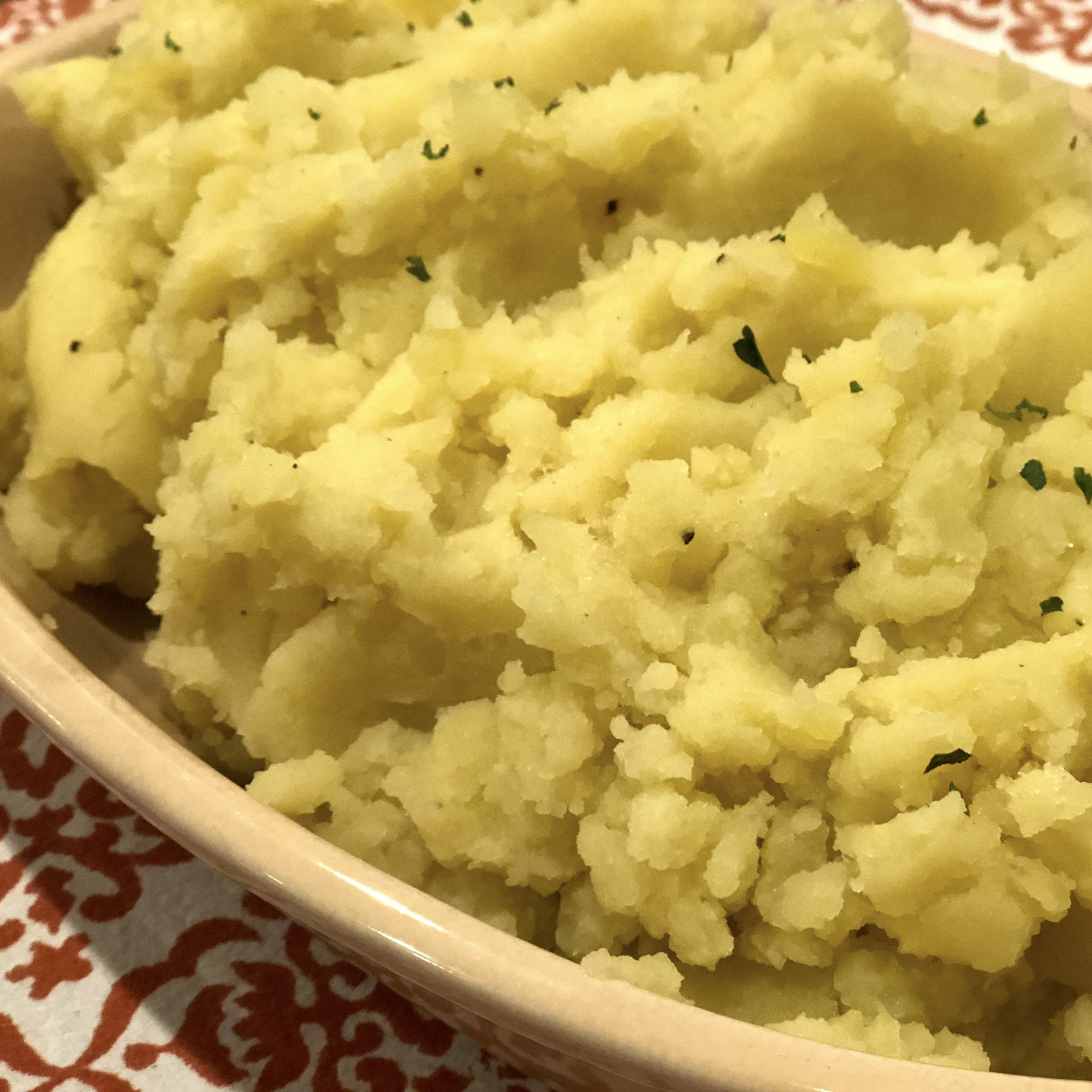 garlic mashed potatoes in an oval dish