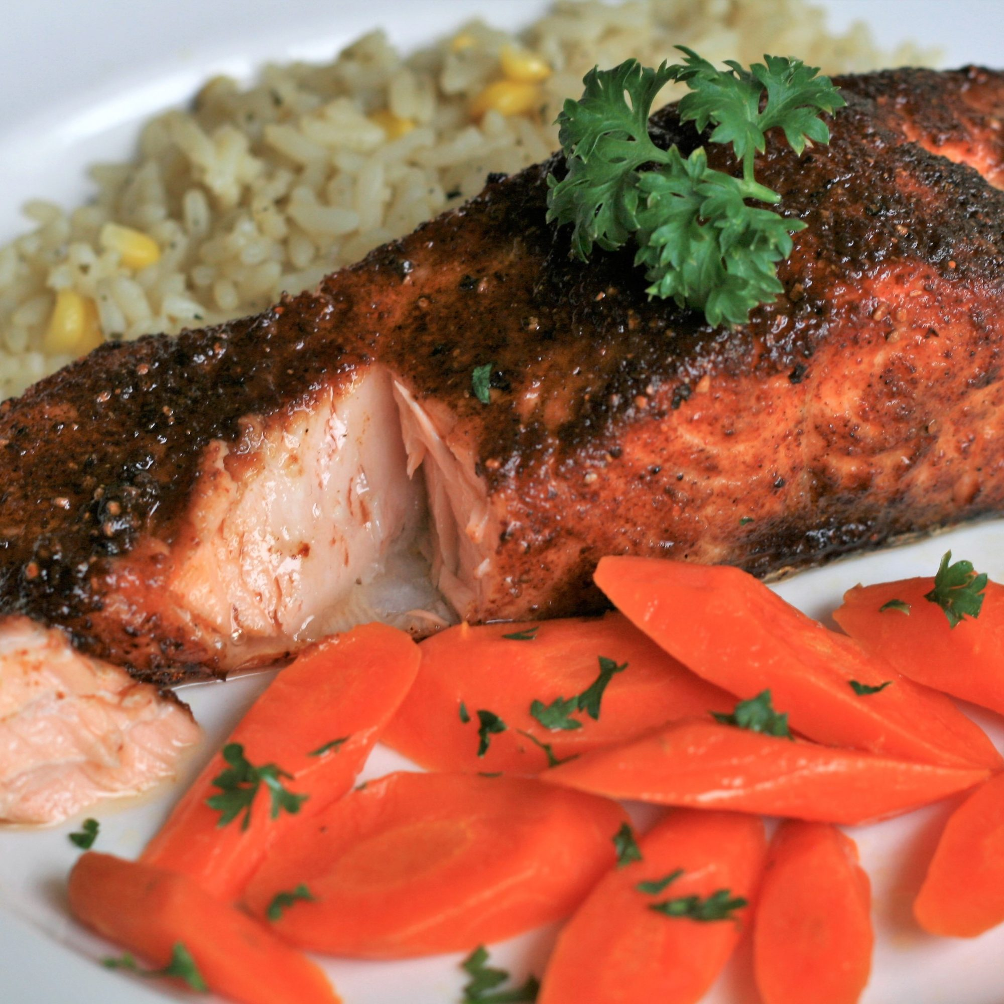 Cajun salmon with carrots and rice