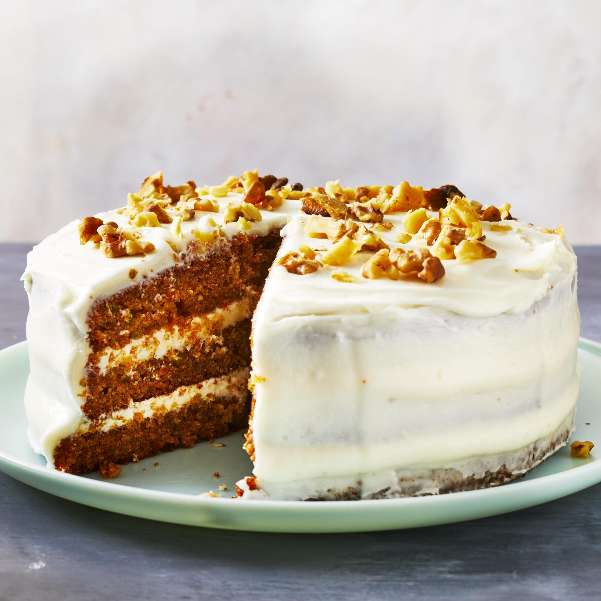 three-layered carrot and zucchini cake on a plate