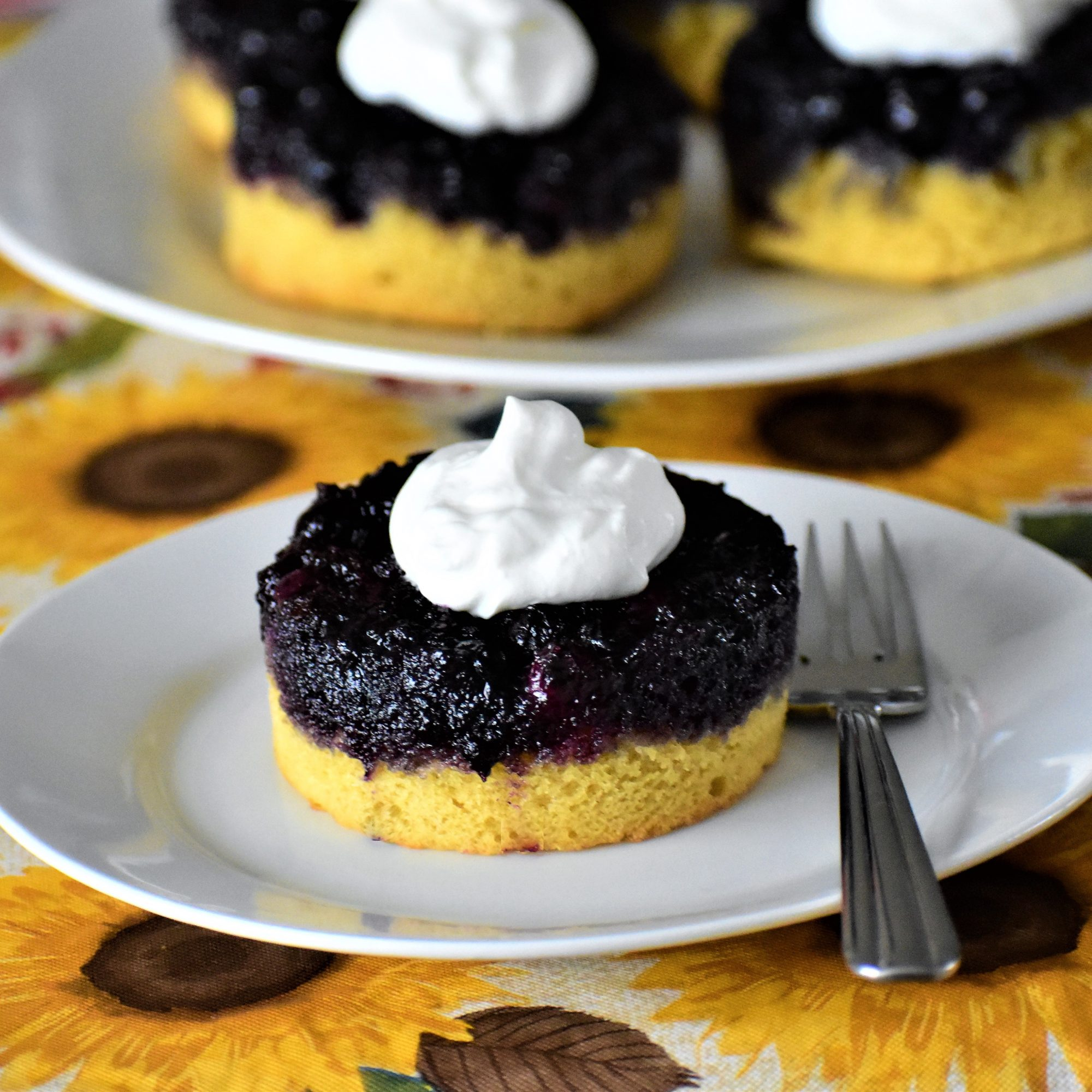 blueberry upside down mini cakes with whipped cream topping