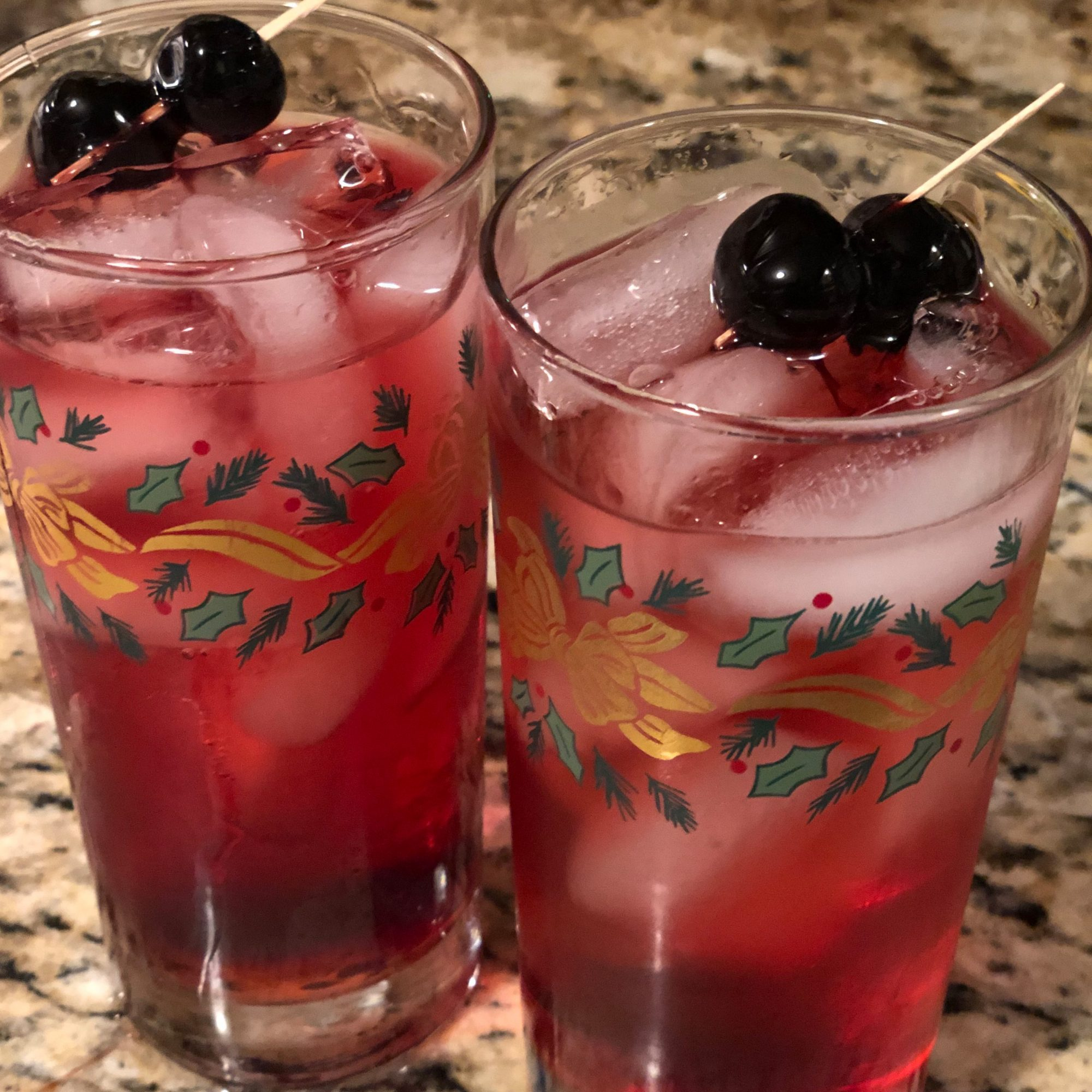 Christmas Cape Cod with cherries on a cocktail pick