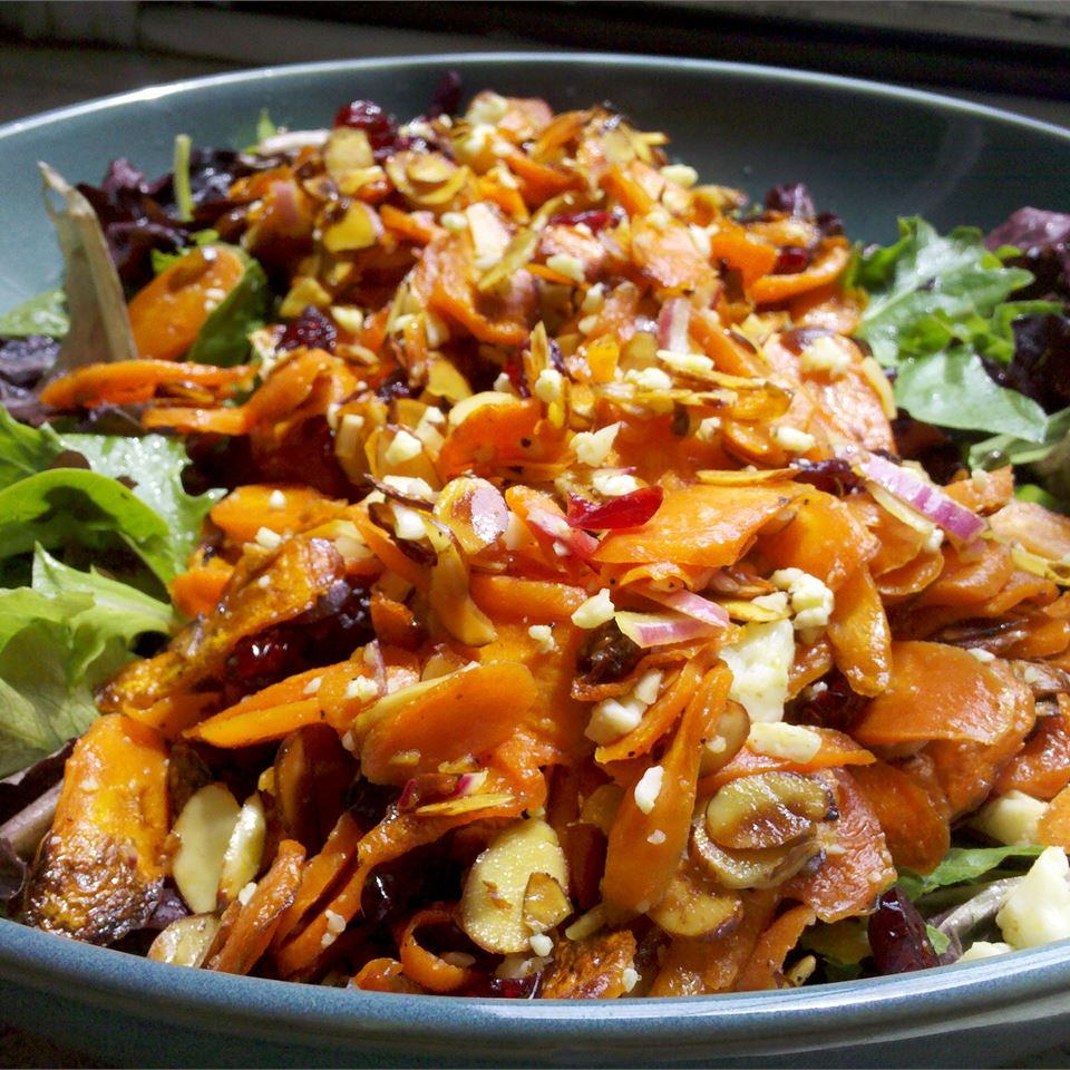 salad topped with roasted carrots and slivered almonds