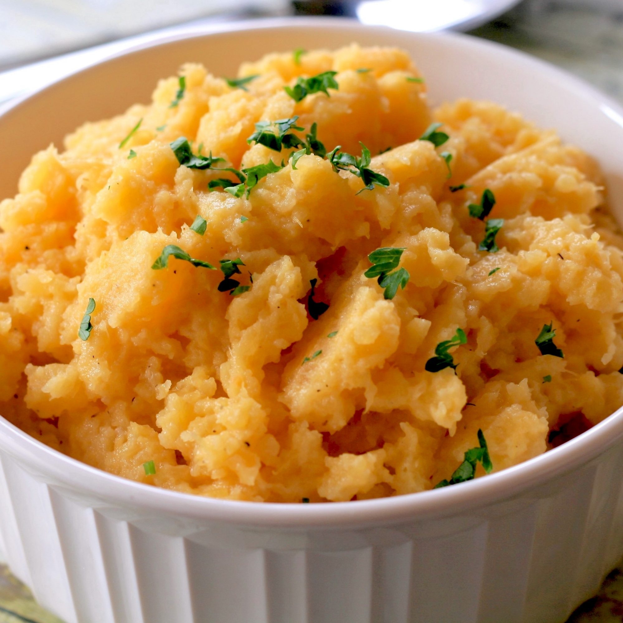 mashed rutabaga in a white dish