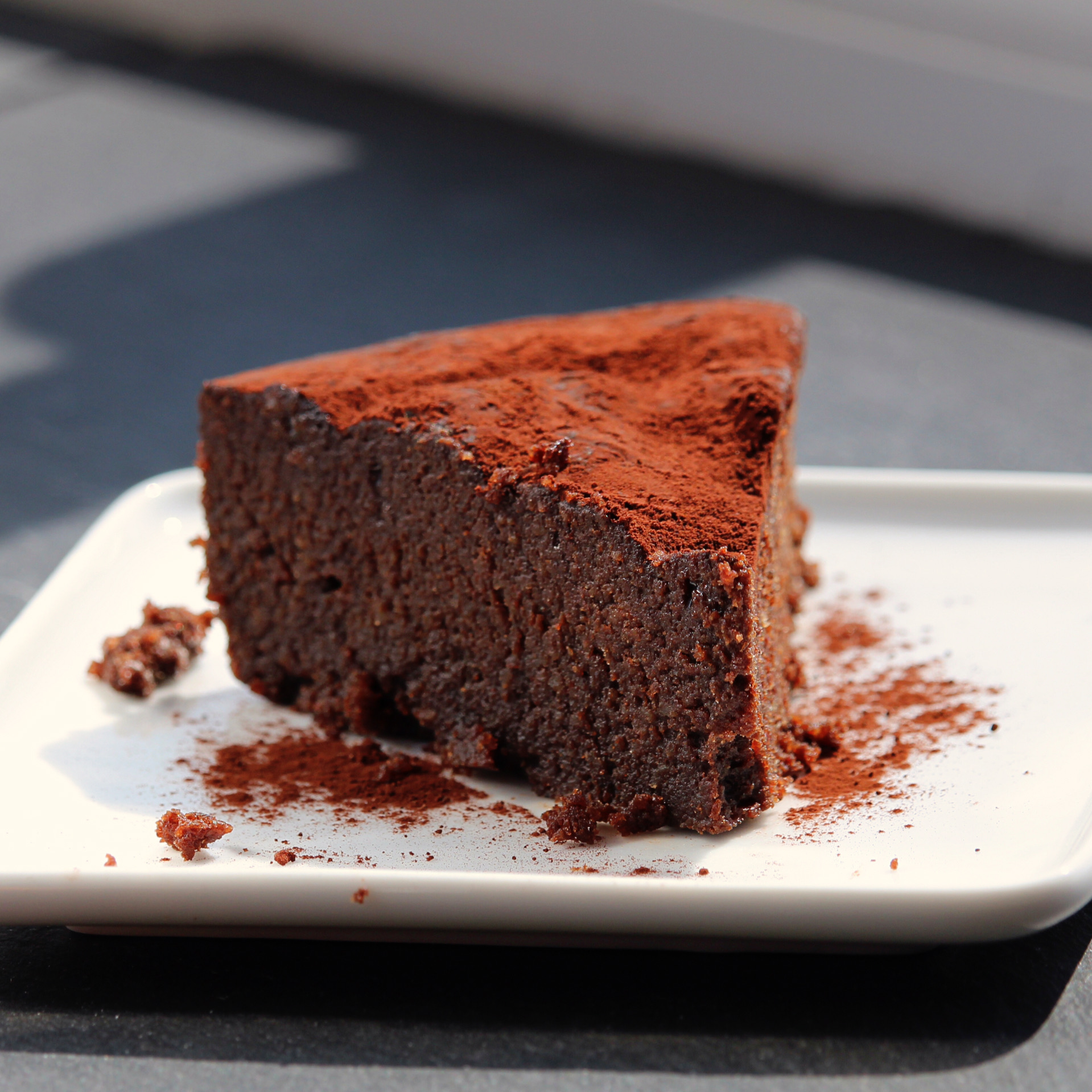slice of flourless chocolate cake on a white plate