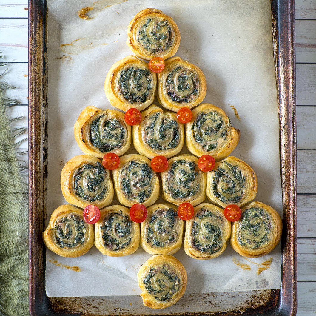spinach puff pastries lined up in a Christmas tree shape