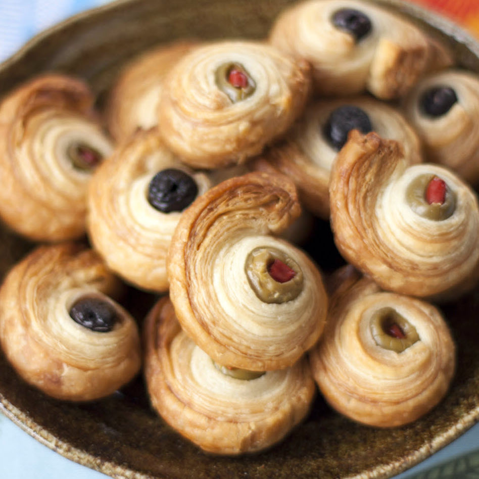 olives rolled in puff pastry on a plate