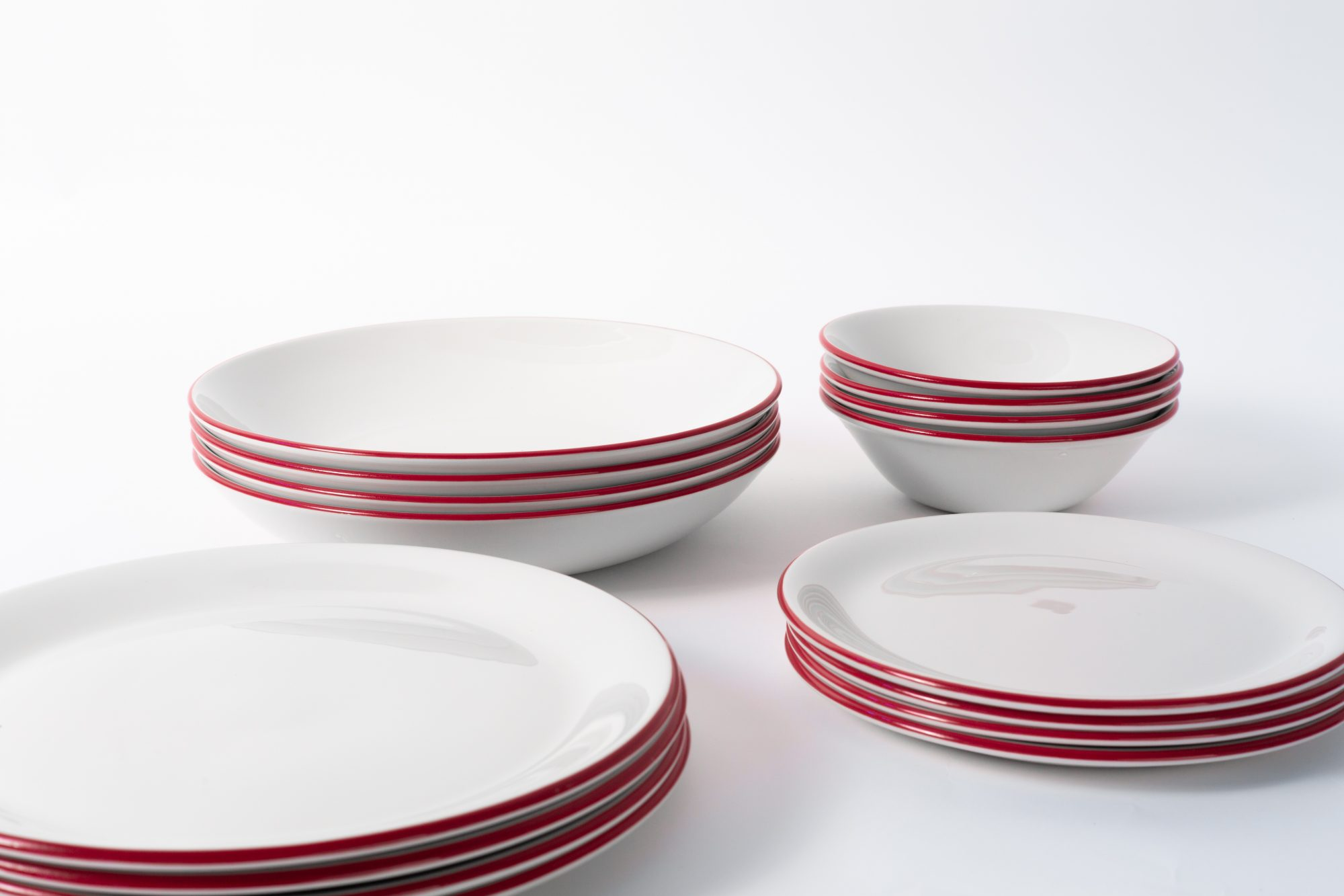4 place sets with bowls and plates, white lined with red