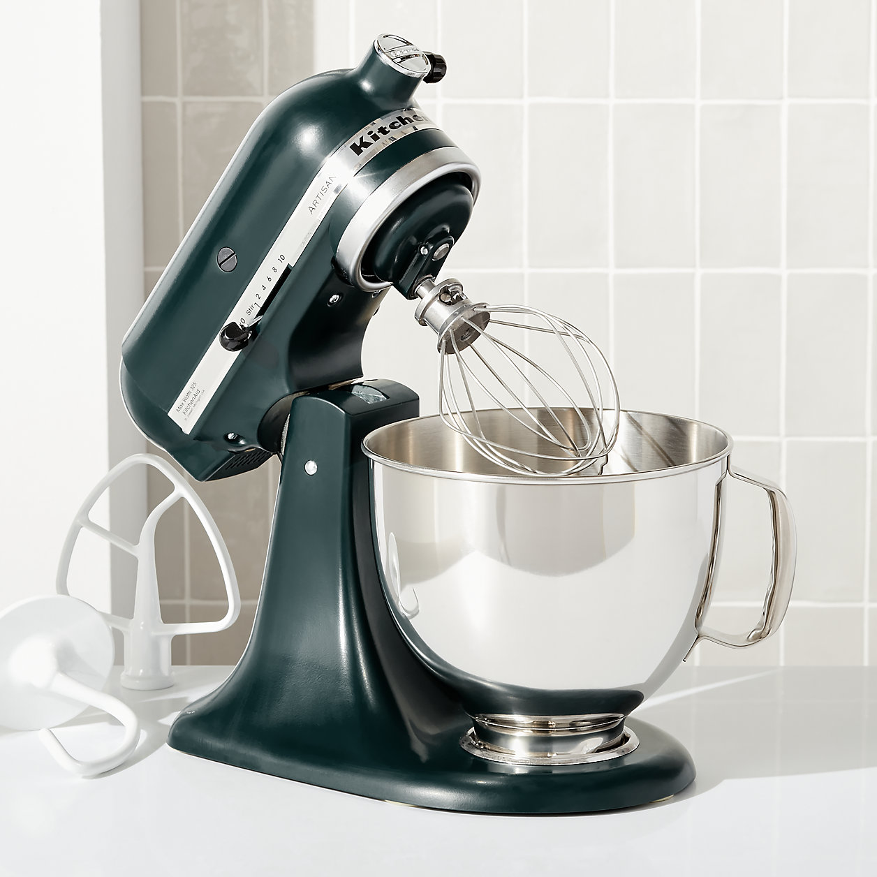 KitchenAid Stand Mixer with dark green exterior and stainless steel mixing bowl on countertop