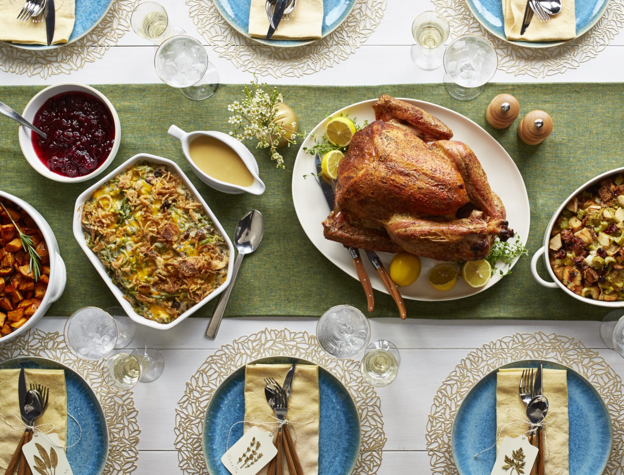Thanksgiving dinner with turkey, cranberries, and casserole