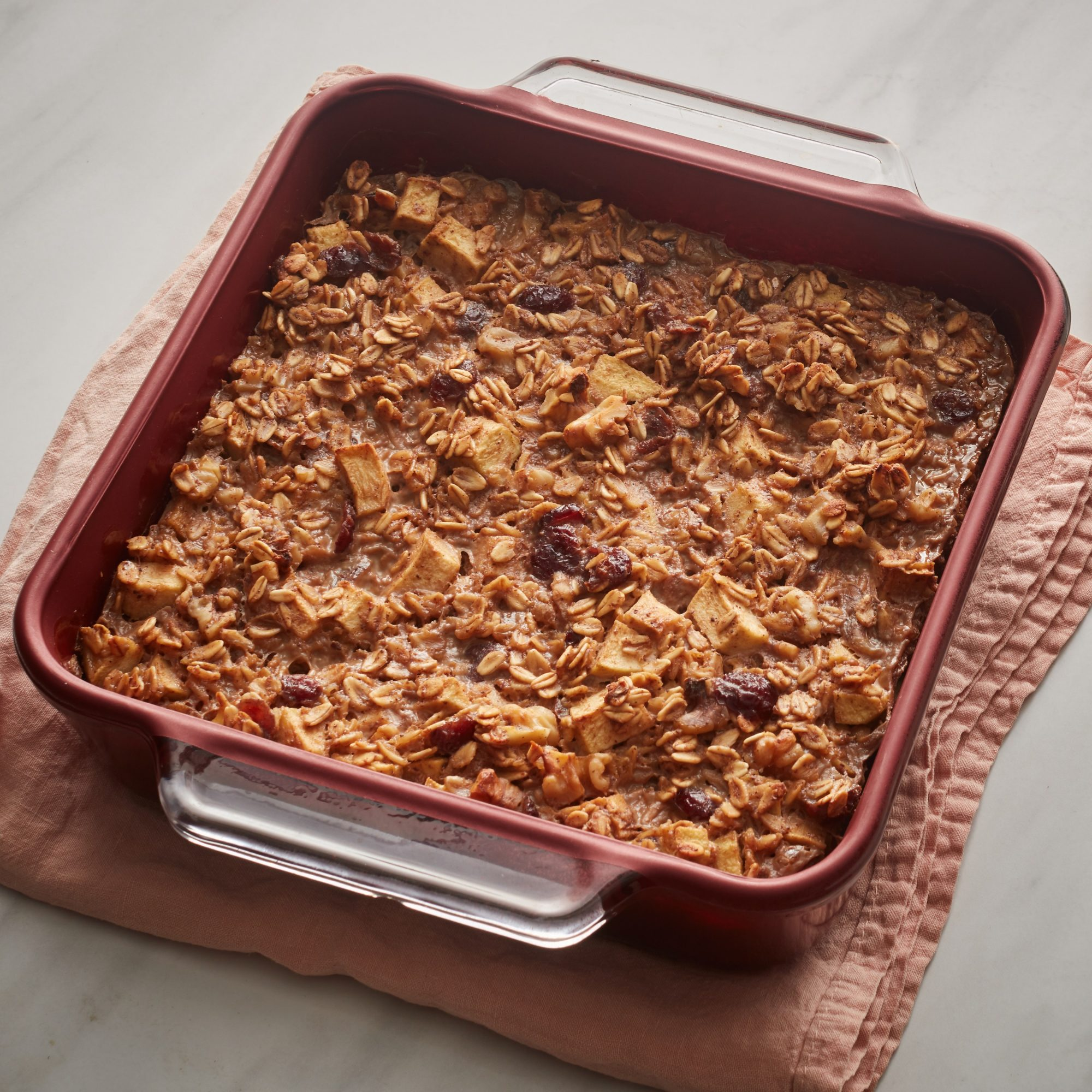baked oatmeal with cranberries in a pink can