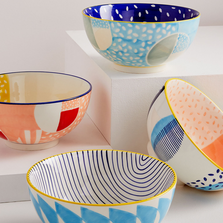four colorful printed bowls