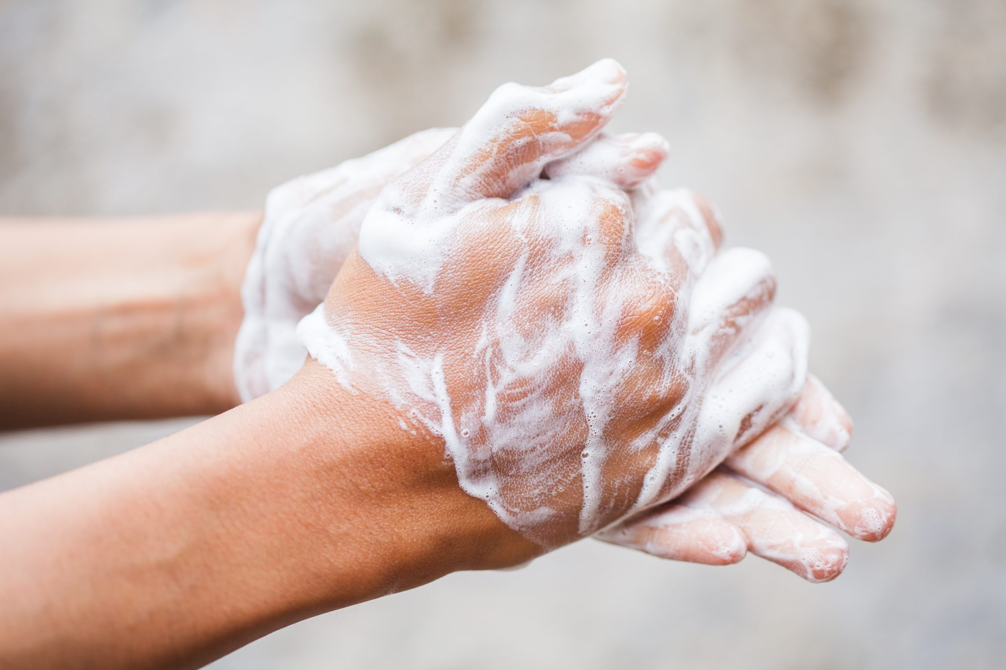 A man washing hands with soap