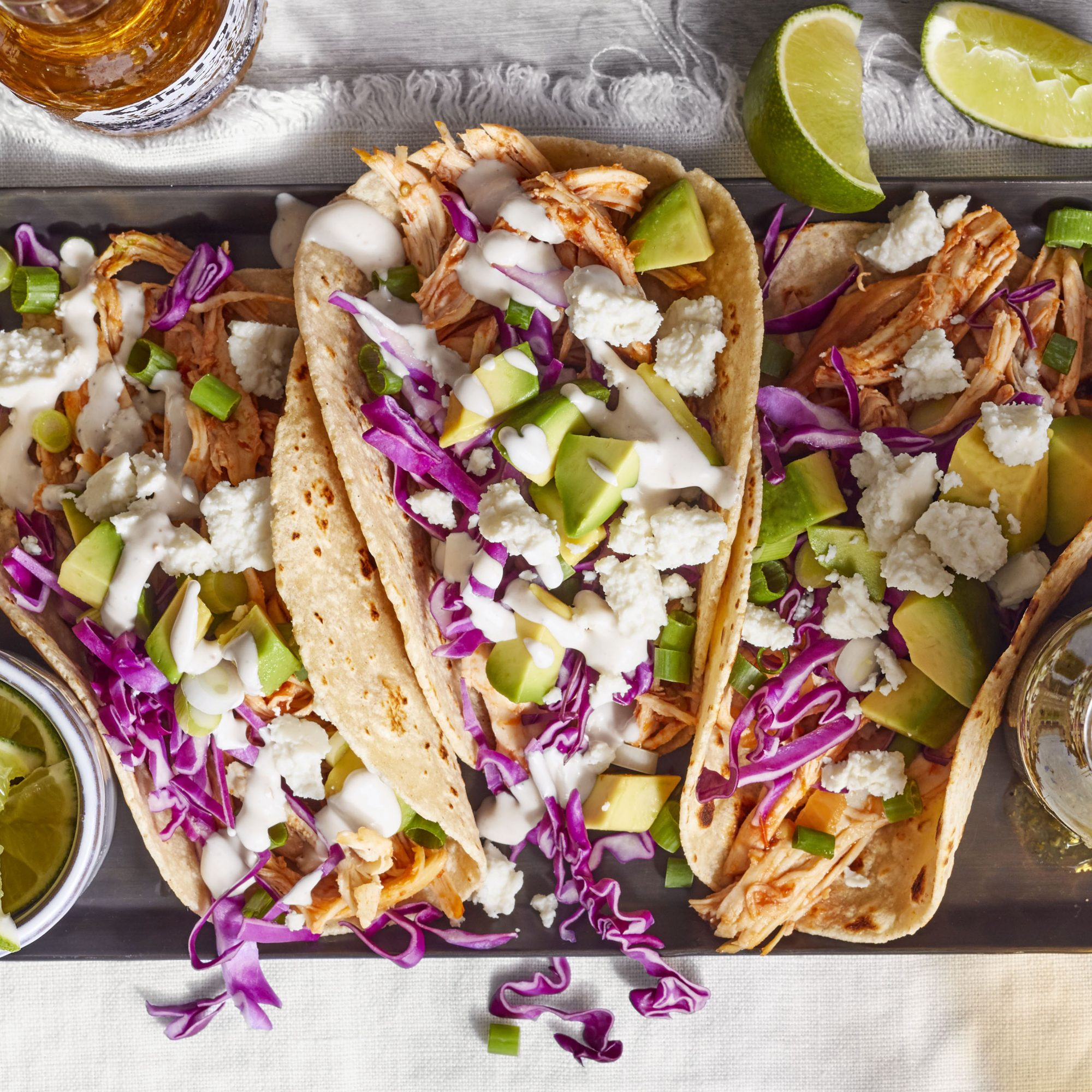 leftover turkey in tortillas with cabbage, avocado, and cream sauce