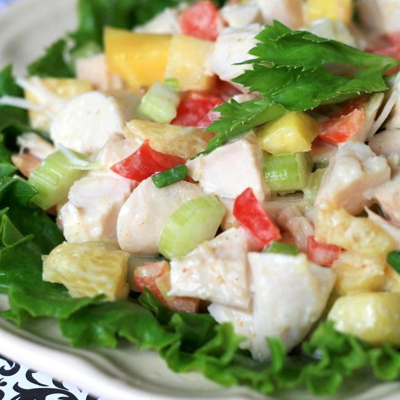 turkey with grapes, celery, mango over lettuce