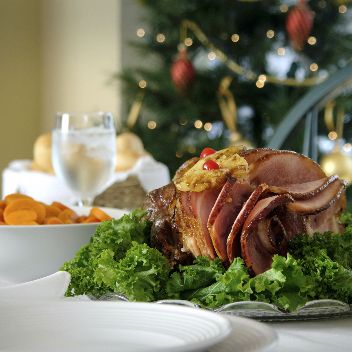 Christmas table with roasted ham