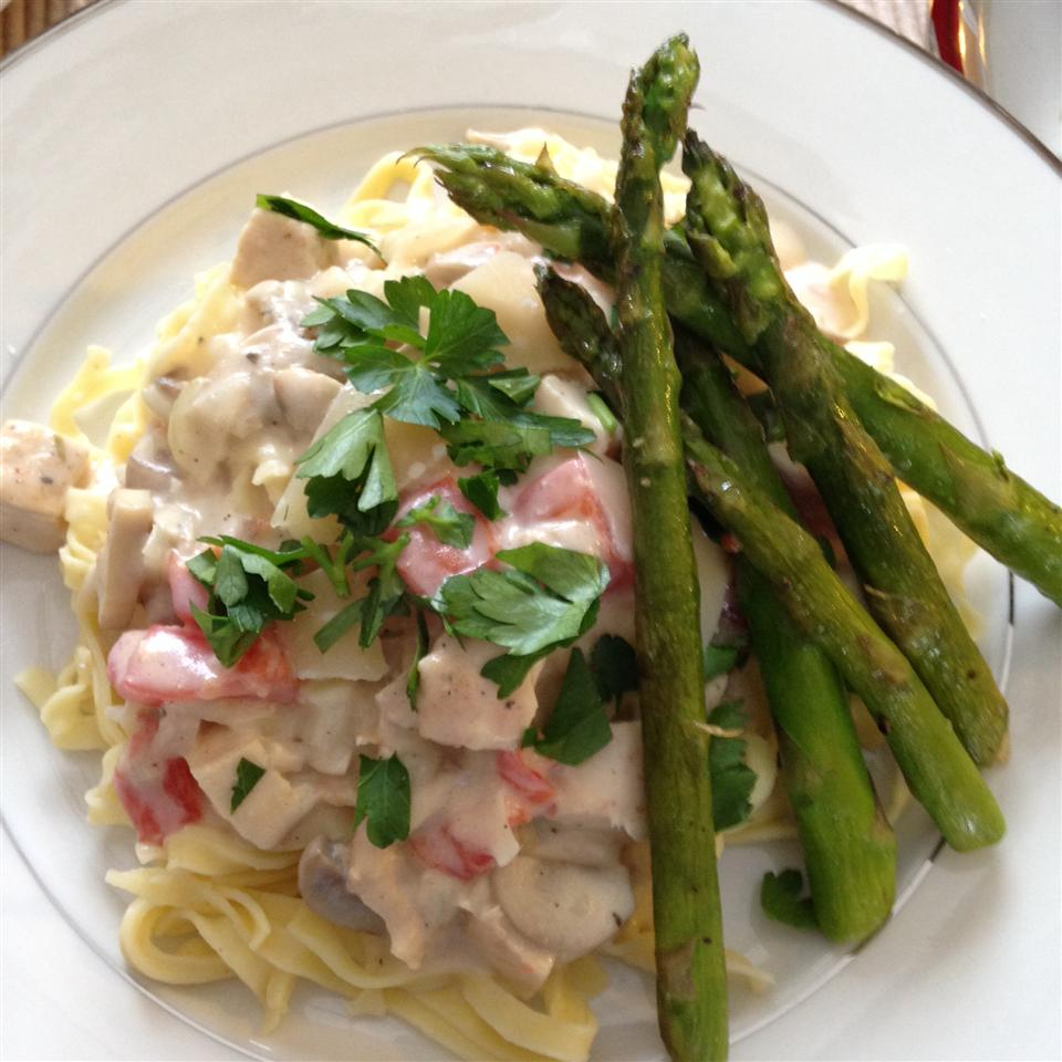 plate of chicken fettucini fredo with asparagus side dish
