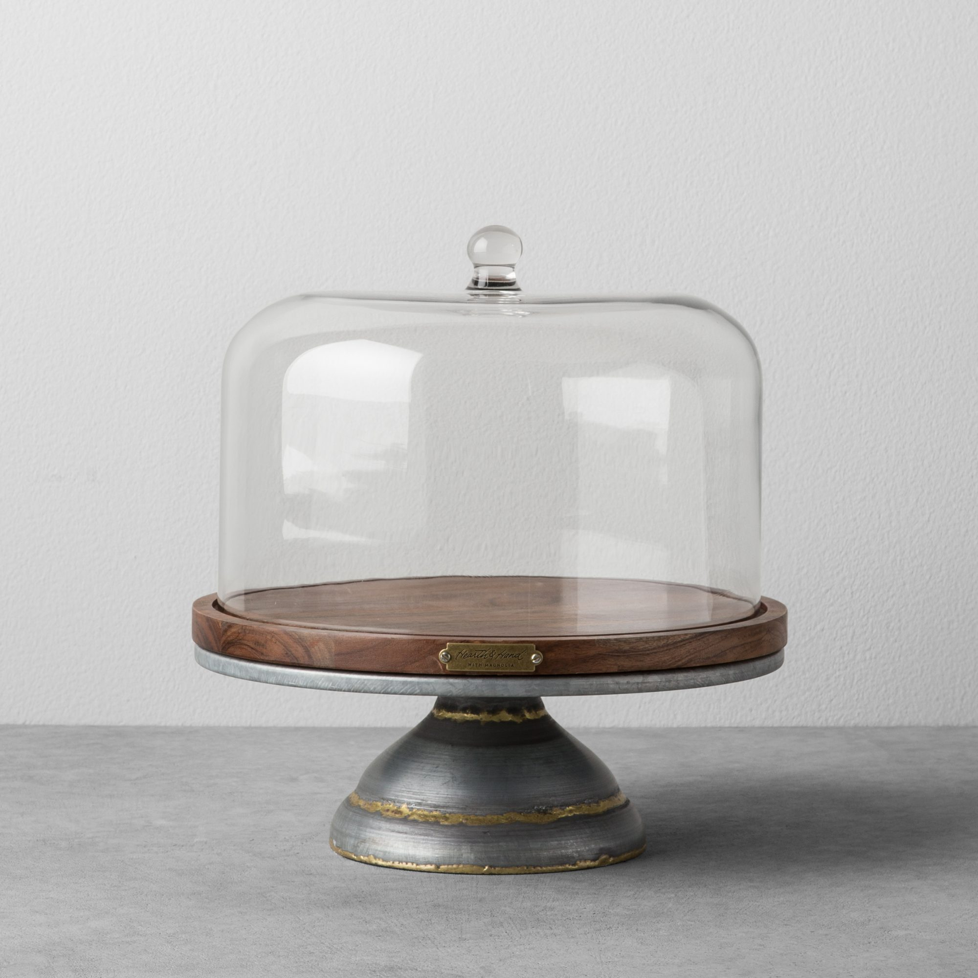 Wood and Metal Covered Cake Stand on a grey background