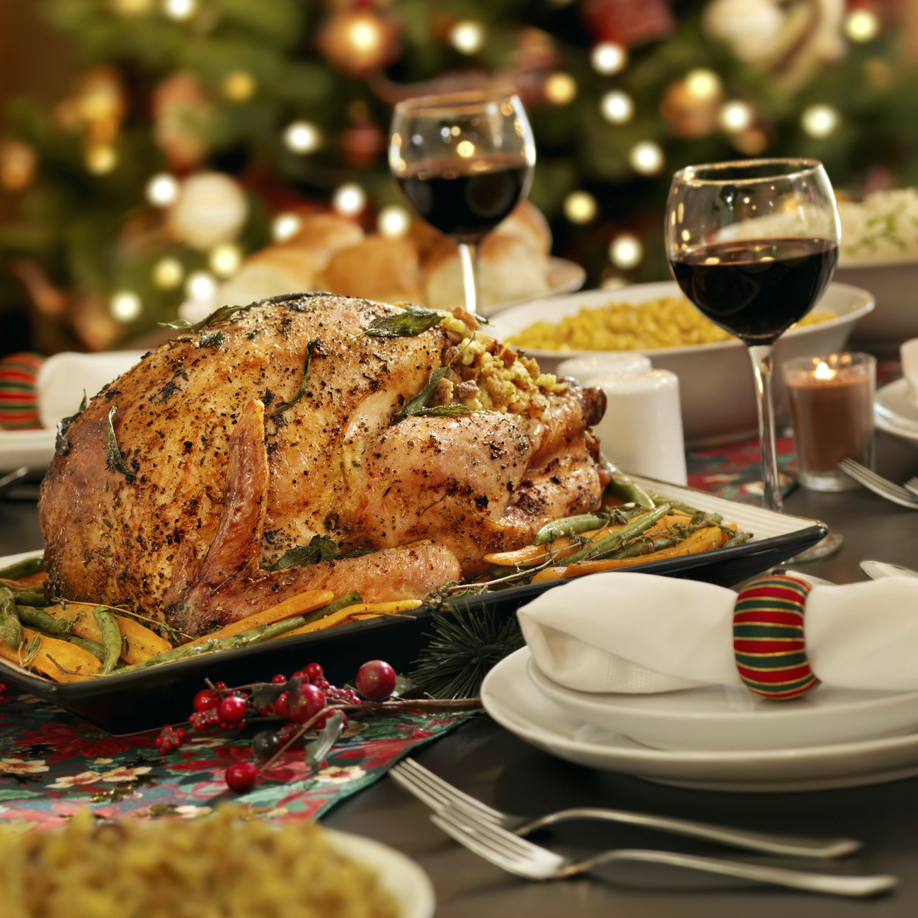turkey on a Christmas table with red wine, corn, mashed potatoes