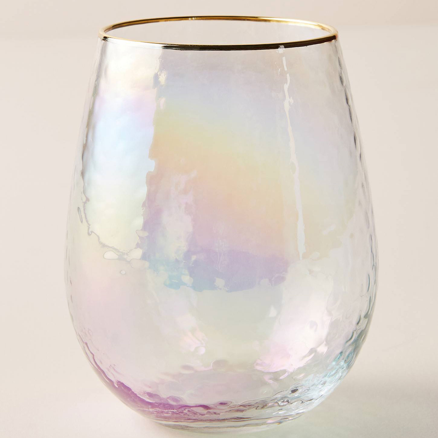 Lustered, stemless wine glass with gold rim