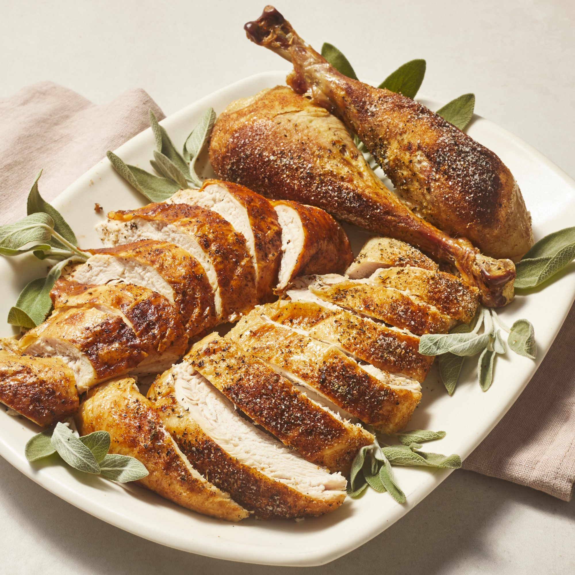 Platter of carved turkey with rosemary sprigs