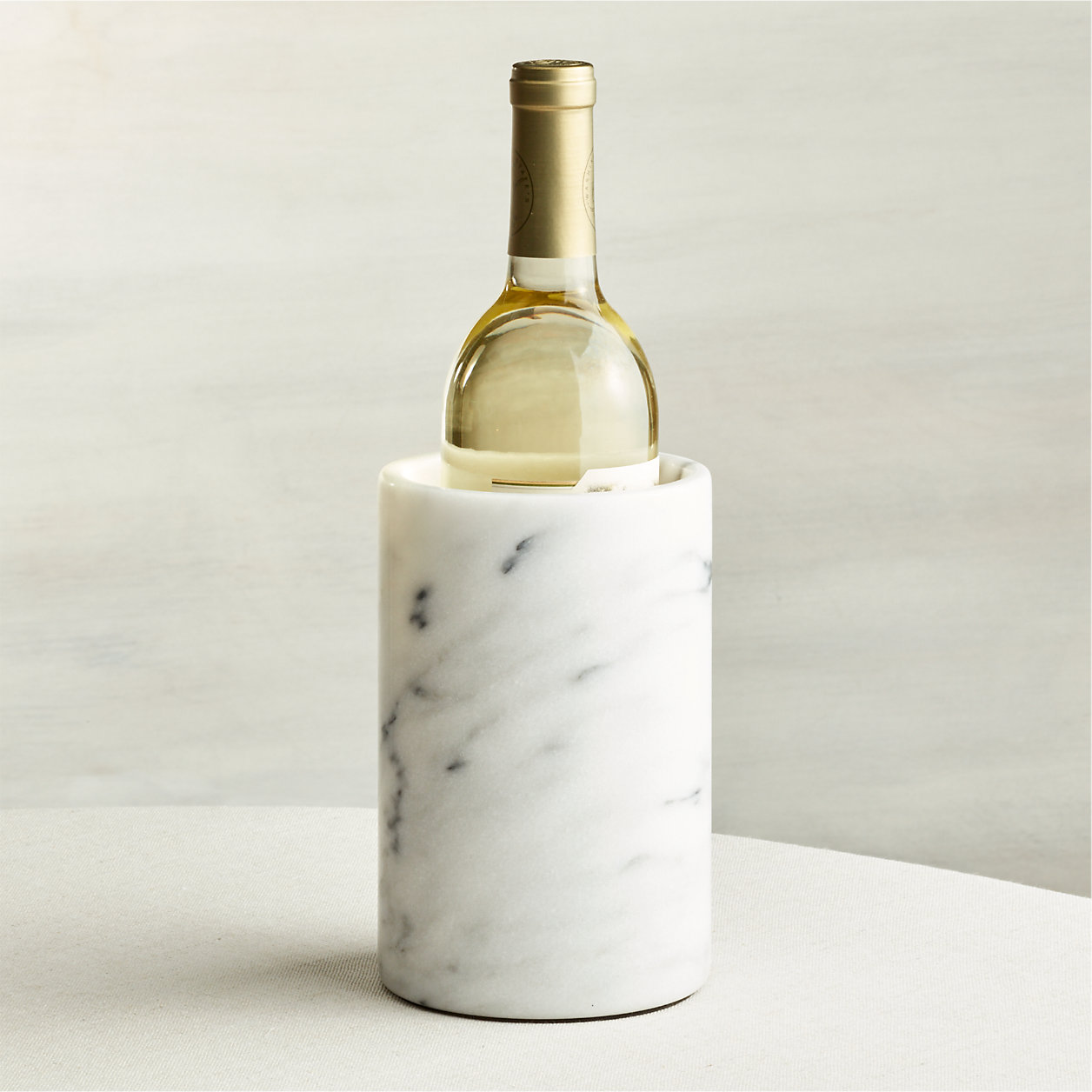 Marble wine chiller with bottle of wine inside