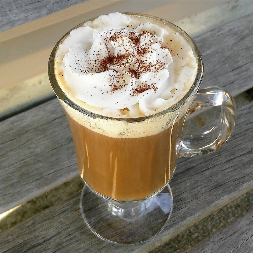coffee drink in a glass mug with whipped cream