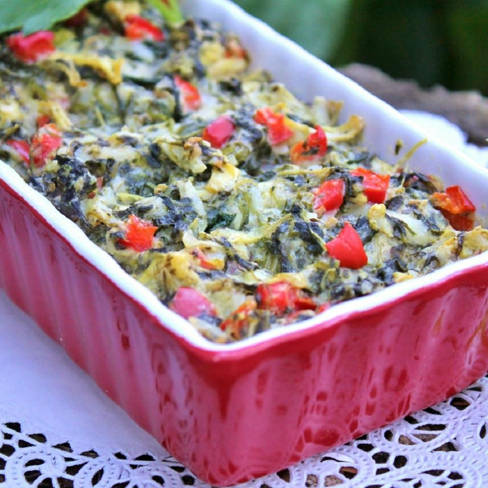 spinach dip in a red container