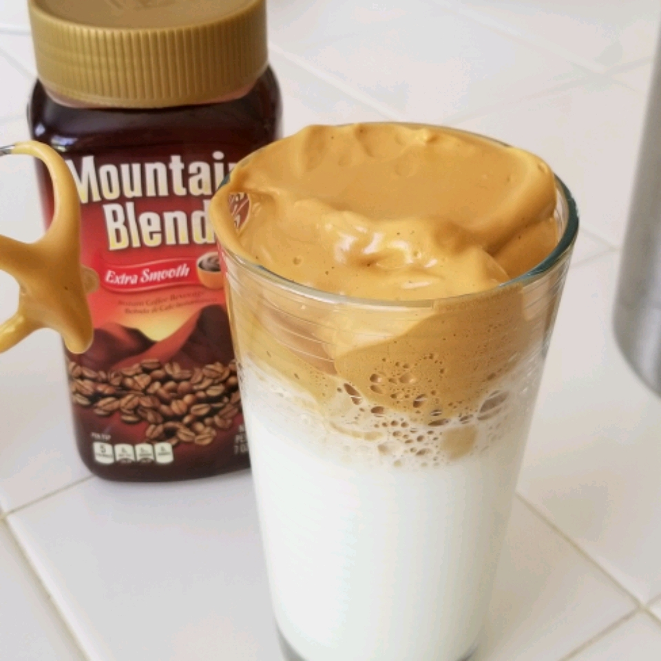 whipped coffee in a tall glass
