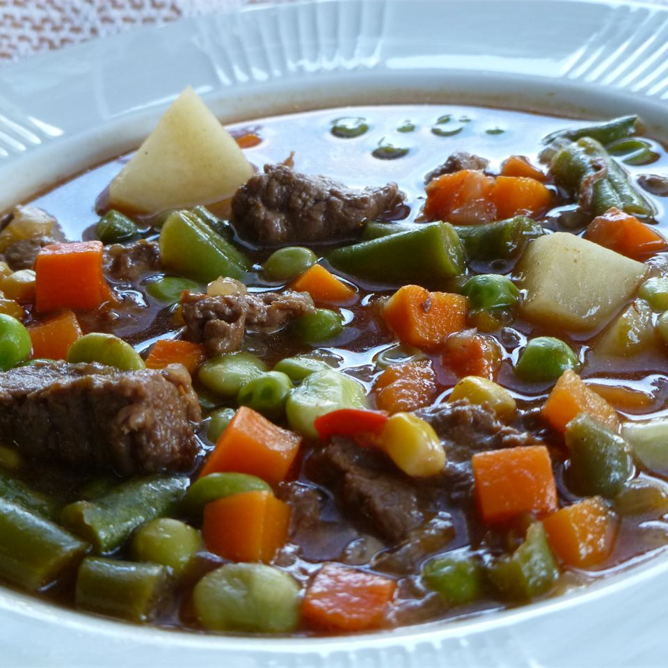 Beef soup with carrots, corn and potatoes