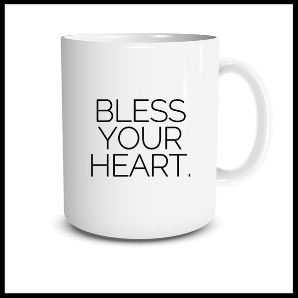 "White mug with ""bless your heart"" text in black"