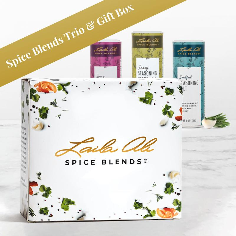 White Laila Ali Spice Blends Box with three different spice blends in background