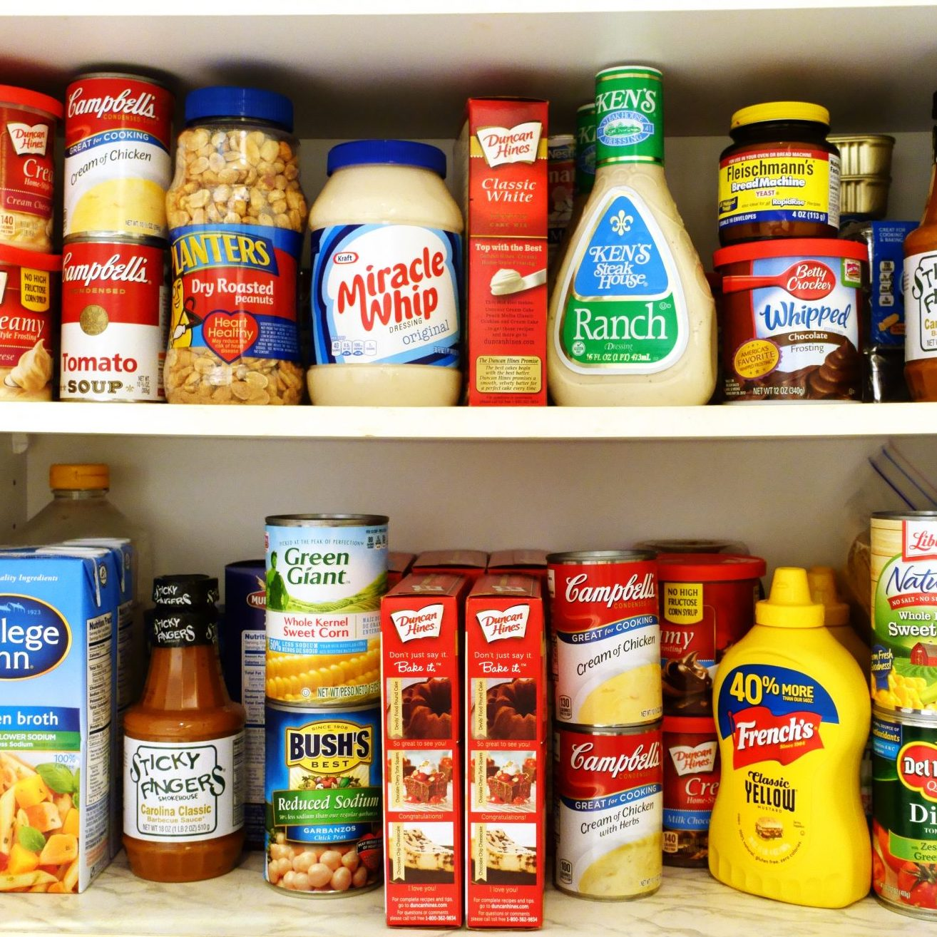 Kitchen pantry shelves filled with groceries