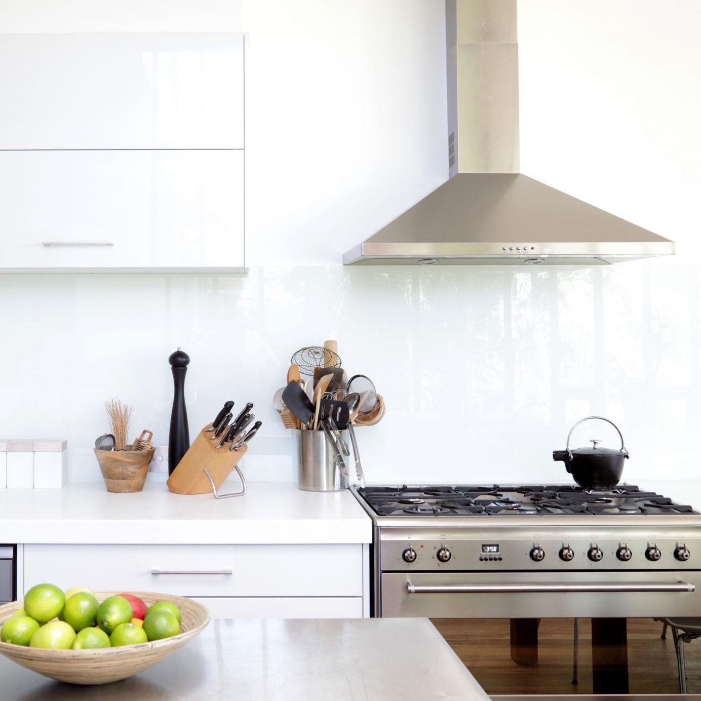 white kitchen with an oven hood
