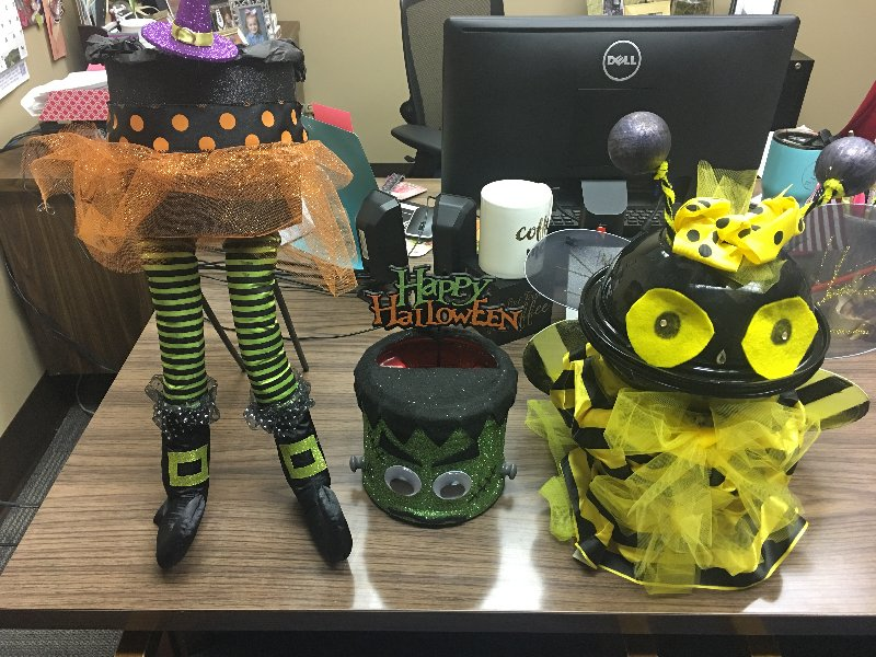 coffee cans repurposed as Halloween decorations