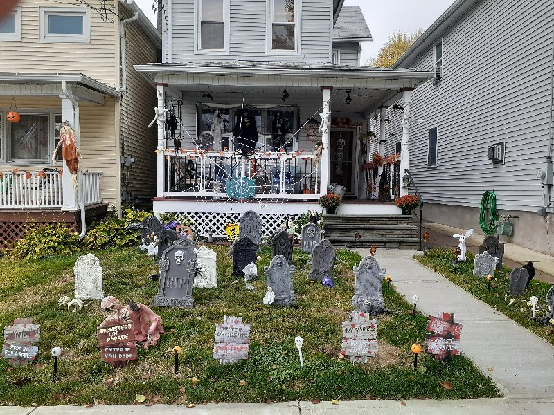 grey house with gravestone decorations in the front yard