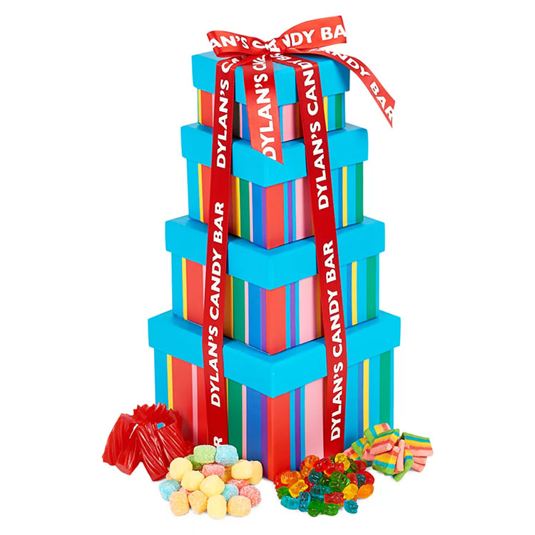 Three colorful boxes stacked on top of each other with candy at the base