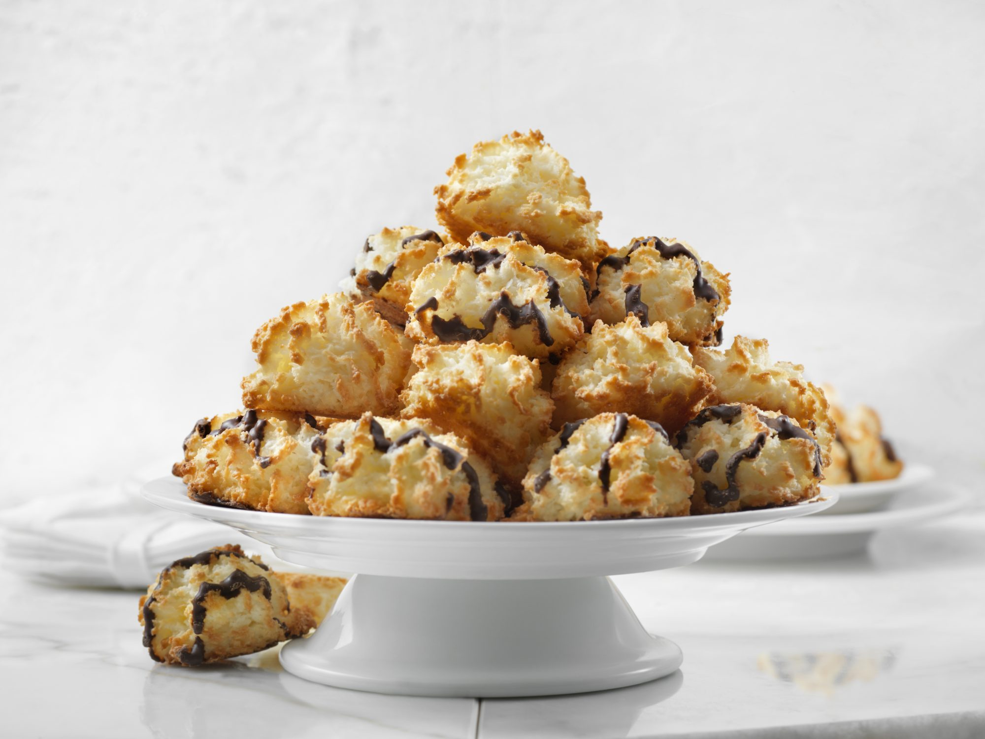 chocolate-drizzled coconut macaroons on a platter