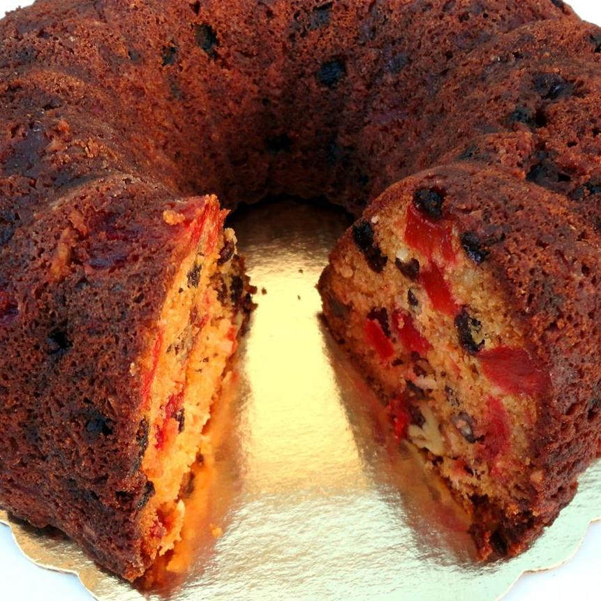fruit cake with a slice cut out