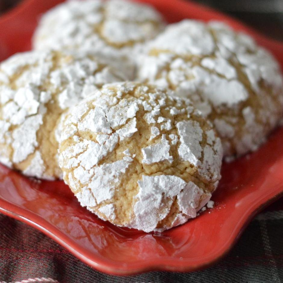 sugar cookies coated in powdered sugar on a red plate