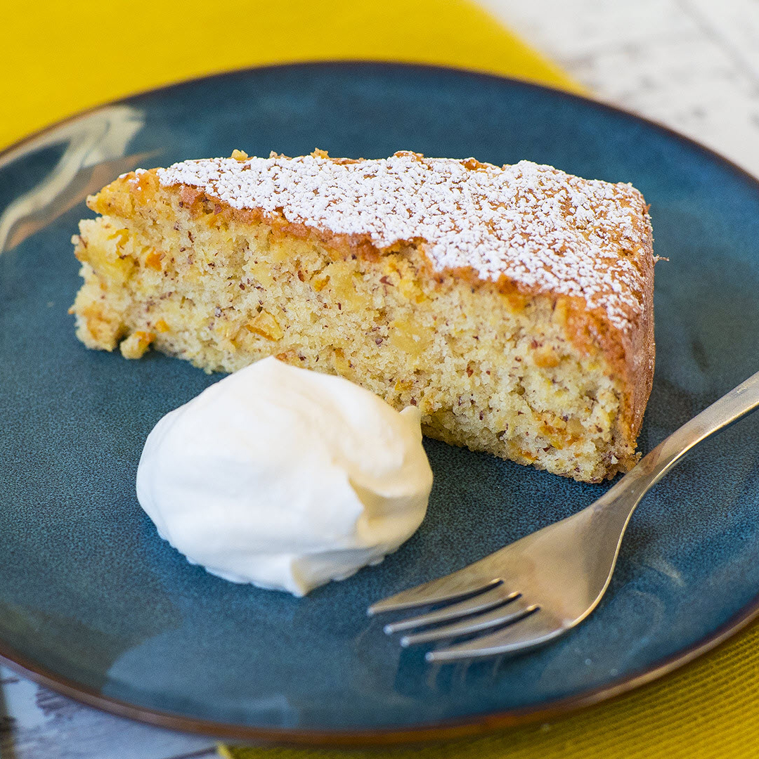 Orange Cake with Semolina and Almonds on a blue plate