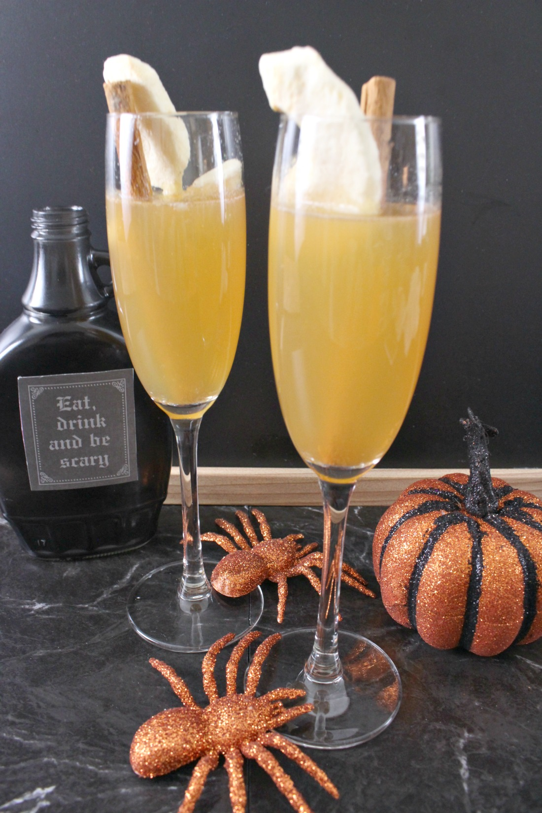 Two Apple Cider Mimosas with halloween decor