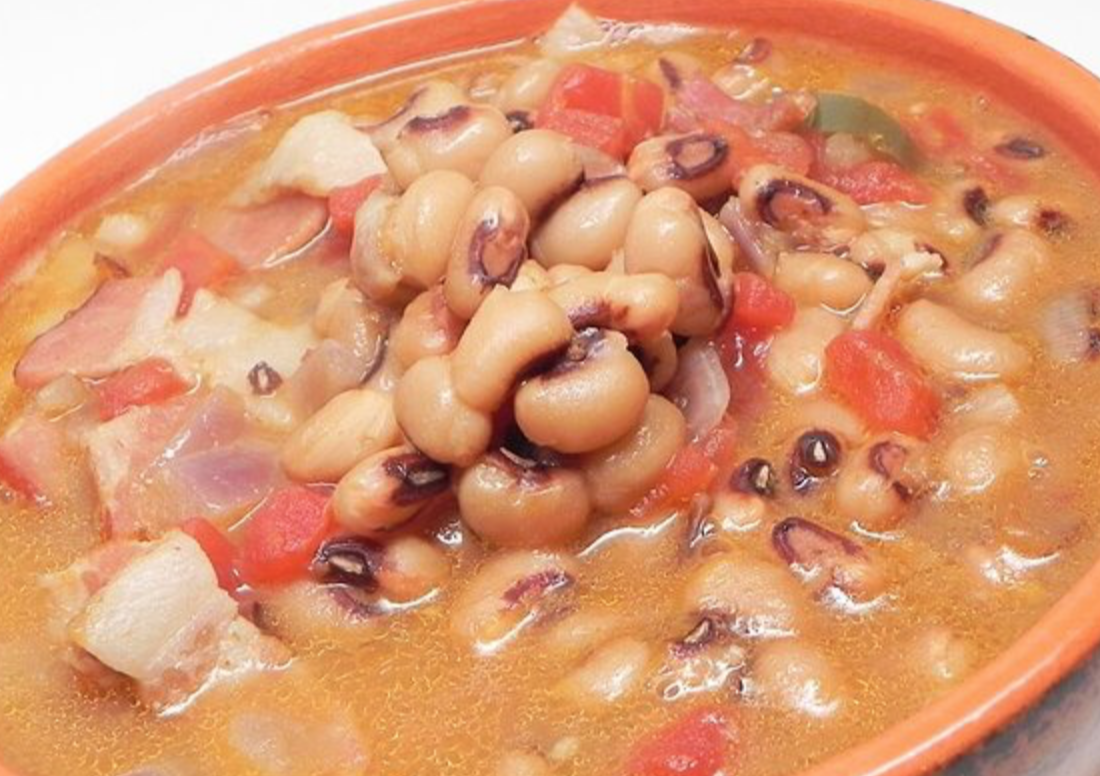 black eyed pea soup in a full red bowl