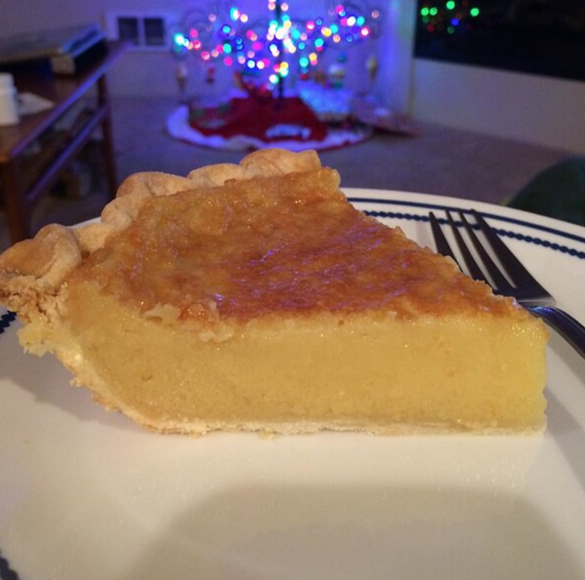 slice of eggnog pie on plate with christmas tree