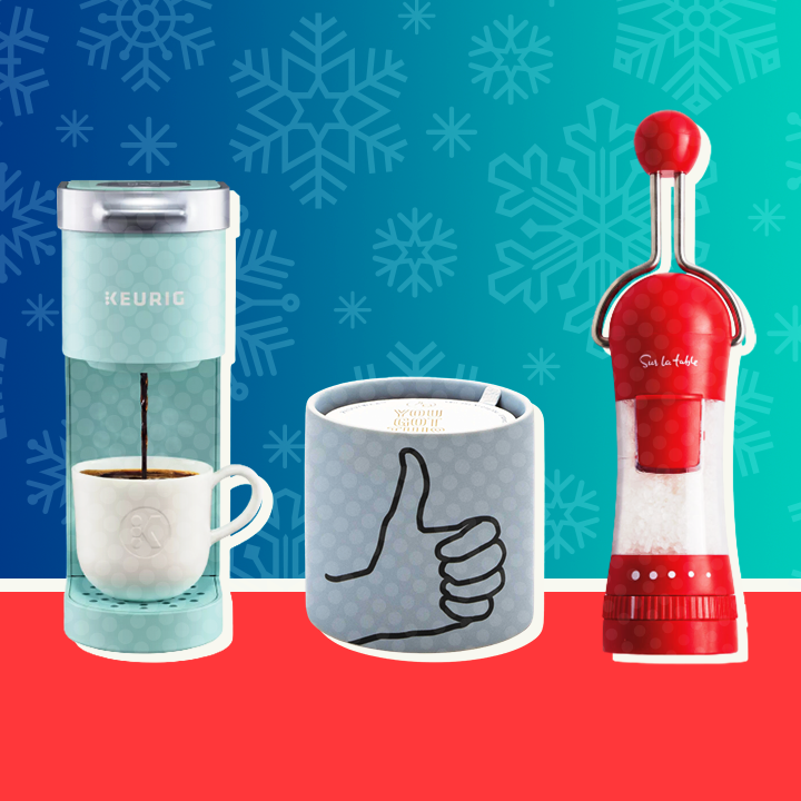 A keurig, candle, and pepper mill with a snowy background