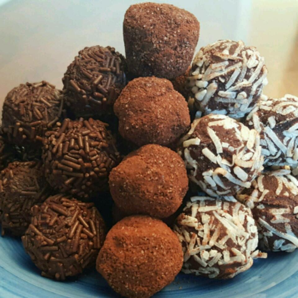 plate of homemade rum truffles rolled in a chocolate sprinkles, cocoa powder, and coconut